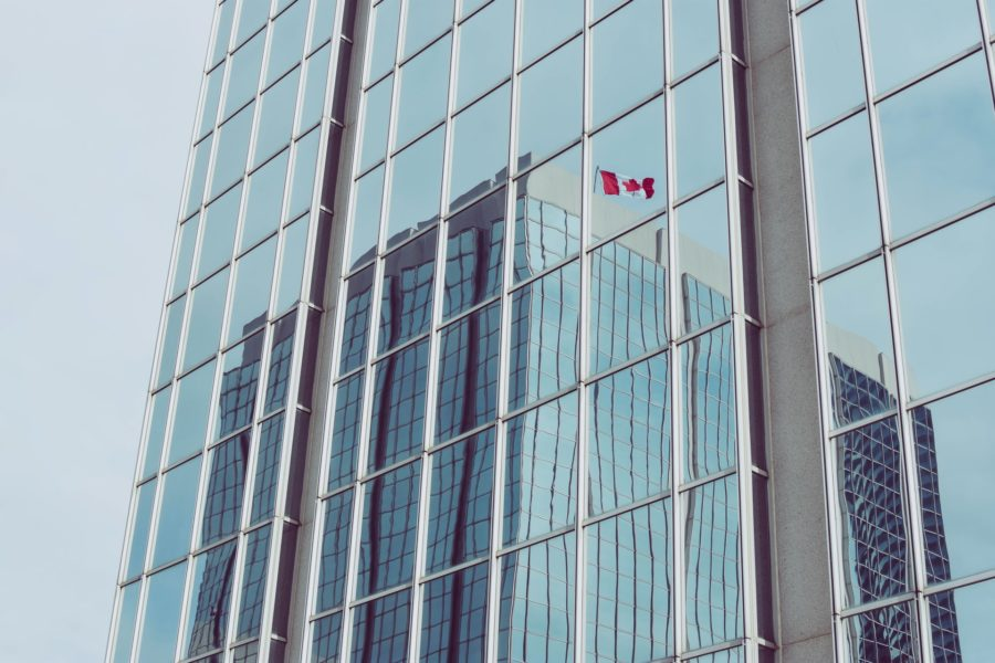 Canadian flag reflected on building